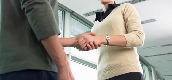 Handshake between a woman and man, meeting a potential client