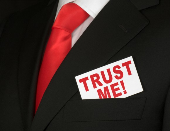 Salesman with ' Trust me!' sign