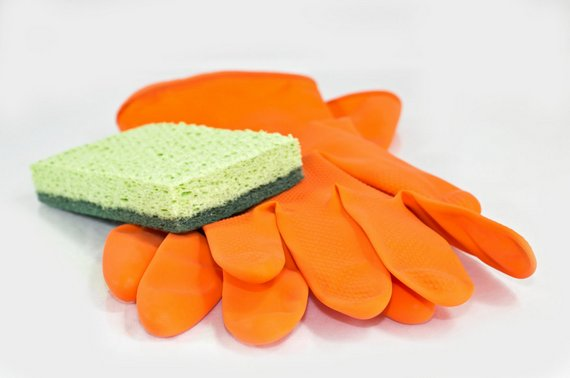 Cleaning sponge with a pair of gloves