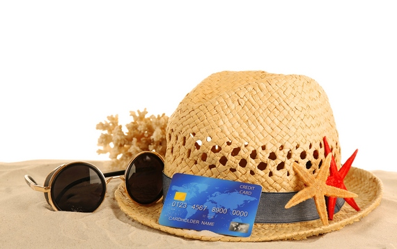 A straw hat with sunglasses and a card